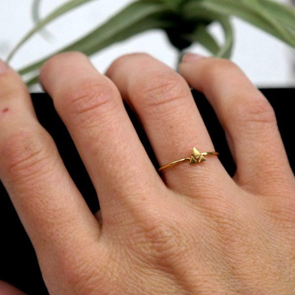 wearing gold mountain ring